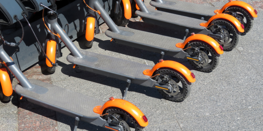 Ride share electric scooters in a dock